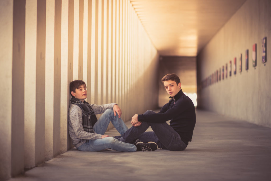 Teenager boys in a tunnel with magic light.