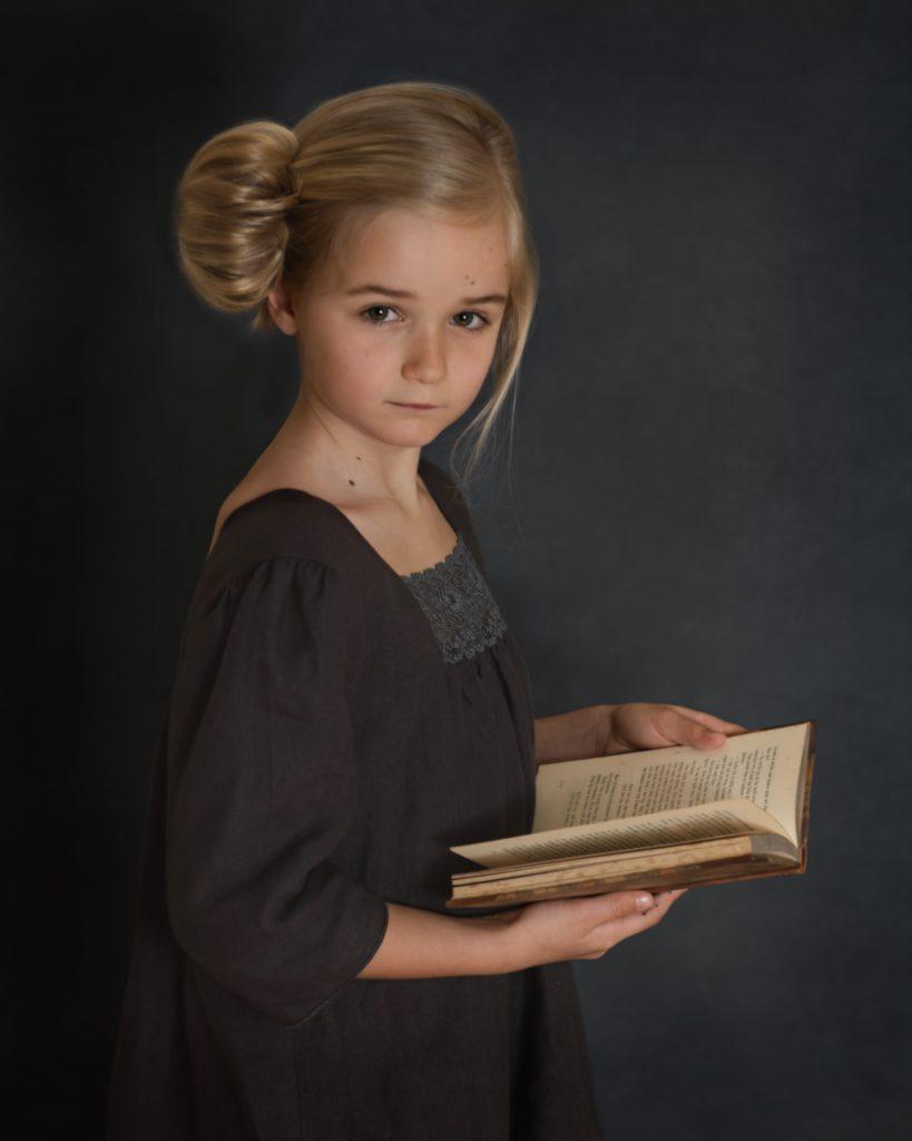 Fine Art Children Photography A little girl with a book.