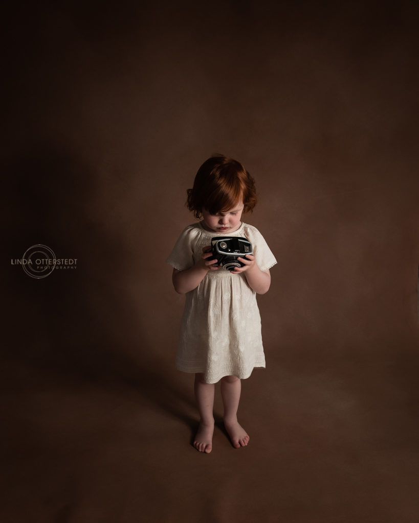 Fine Art Children Photography A little girl with a camera.